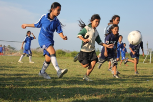 Cambodian girls playing football.