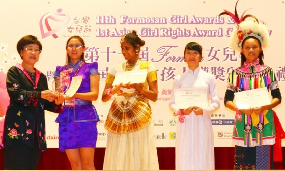 Former Vice-President of Taiwan, Annette Lu Hsiu-lien, announcing the winner of the 1st Asian Girl Rights Award. The first woman vice-president, Ms. Annette Lu, is herself, a champion of human rights.  (From left, Ms. Annette Lu, Tserenbaljir M, Thansila M, Hoai)