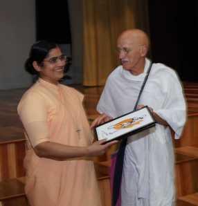 American Gandhi Presenting a Gandhiji sketch to Sr. Swati Maria, Principal, Carmel Convent School